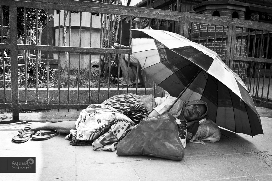 Beggar Camping Outside Temple